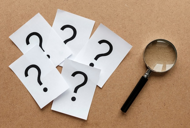 Question marks with a magnifying glass