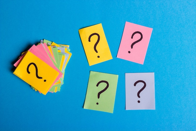 Question marks written reminders tickets
