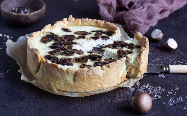 Quiche with champignons and cheese. savory tart with mushrooms.