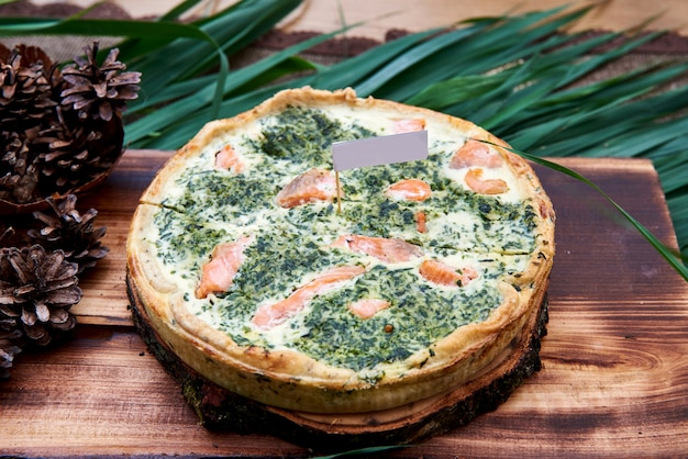 Quiche with fish and spinach, food top view