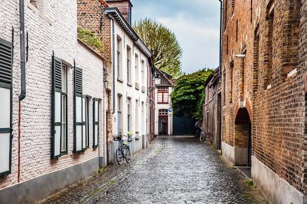 Quiet courtyard, typical architecture of bruges city, belgium