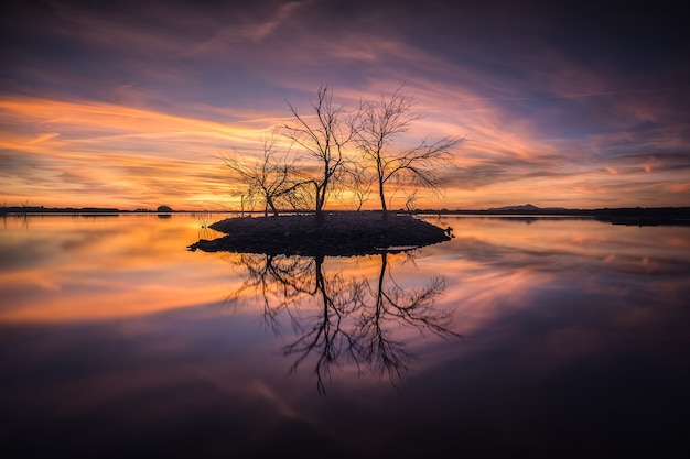 Quiet scene in a lagoon with a colorful sunset. tables of daimiel national park, ciudad real, spain.