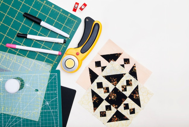 Quilting tools on white background
