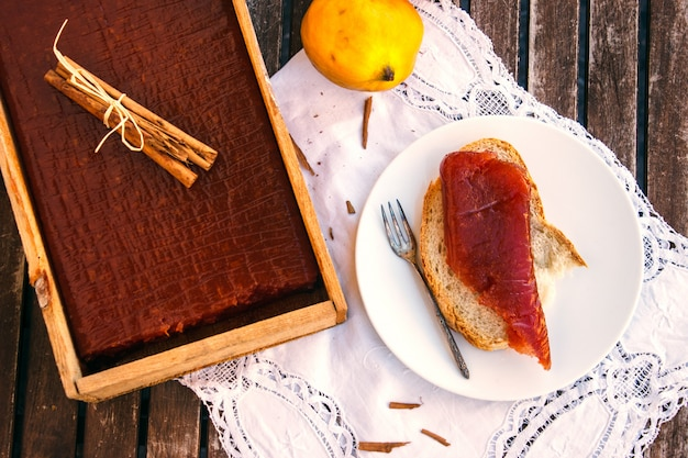 Quince candy box with toast with quince jam