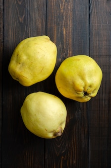 Quince on a dark wooden background. low key.