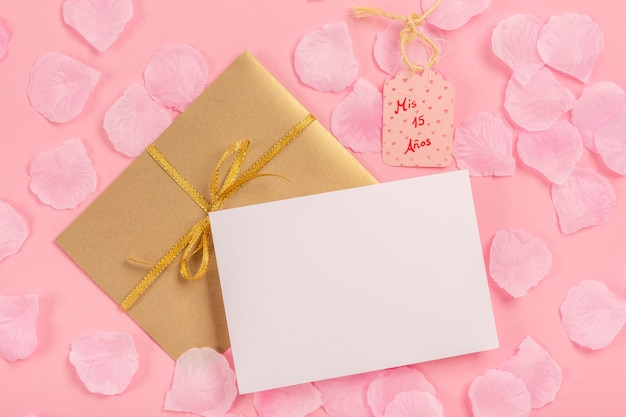 Quinceañera composition with empty card and wrapped gift