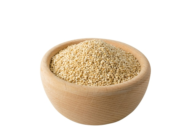 Quinoa seeds in wooden bowl isolated