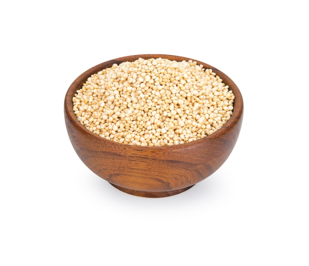 Quinoa in a wooden bowl isolated on white