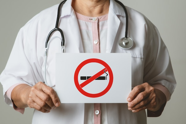 Quit smoking, no tobacco day, doctor holding no smoking sign