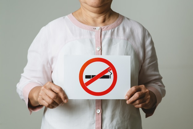 Quit smoking, no tobacco day, mother holding no smoking sign