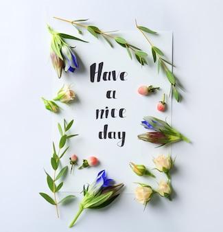 白に葉と花が描かれた紙に書かれた「haveaniceday」を引用してください。