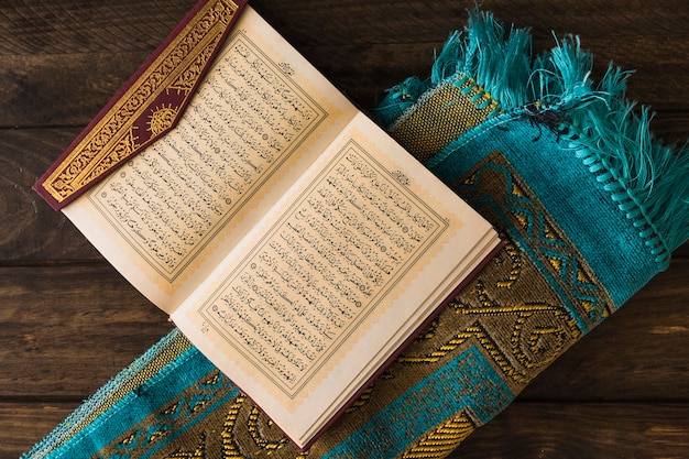 Quran on rolled-up mat