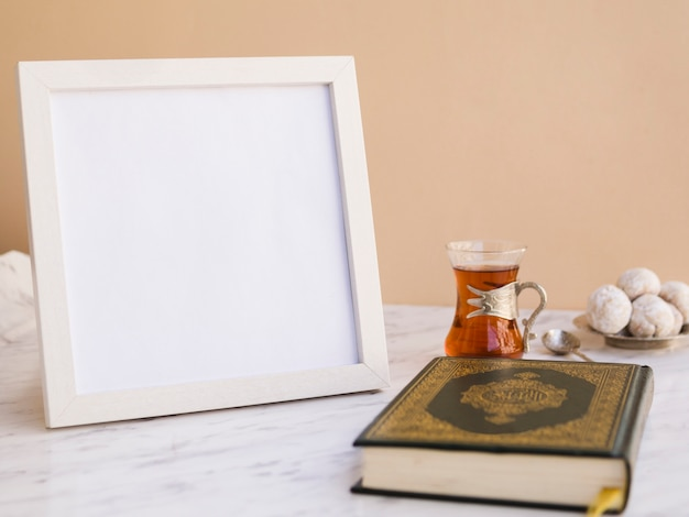 Quran on table with picture frame