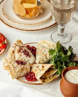 Qutabs and pomegranate with herbs