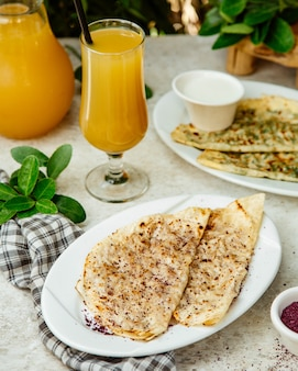 Qutabs served with orange juice
