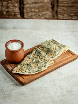 Qutabs with herbs and sour yogurt