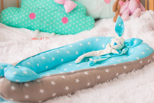 Rabbit comforter. designer cocoon for baby in the form of cradle