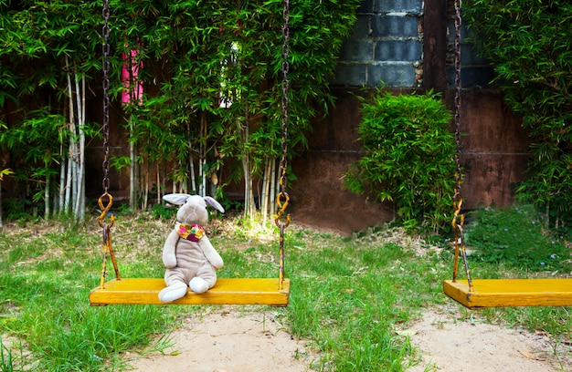 Rabbit doll  on a swing.