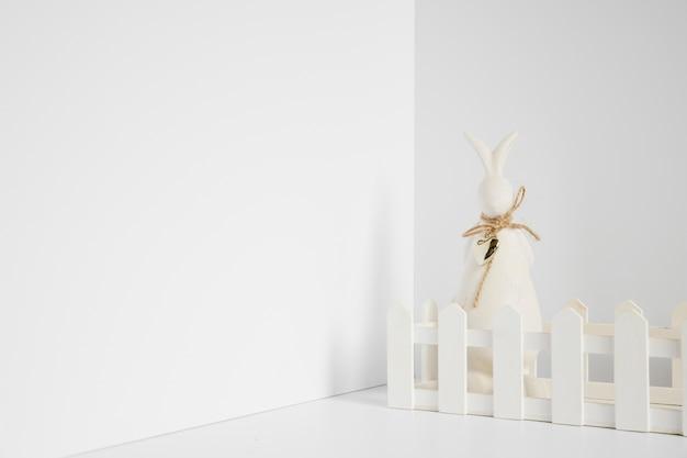 Rabbit figurine at fence