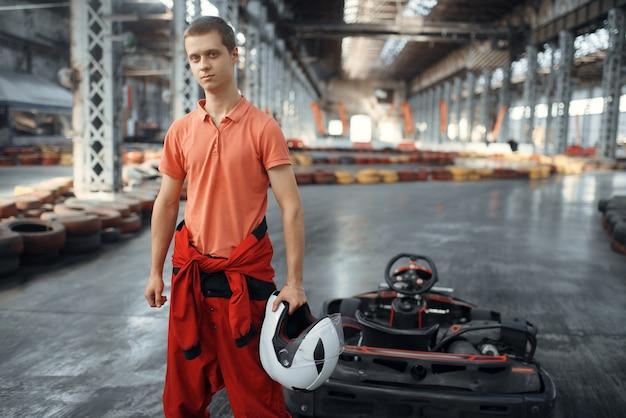 Racer with helmet, go kart car