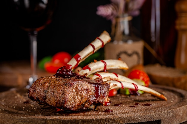Rack of lamb with grilled vegetables and raspberry sauce.