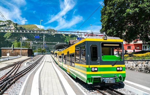 Rack mountain train in wengen above the lauterbrunnen valley in the swiss alps