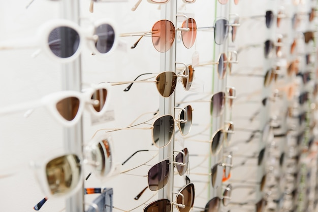 Rack with glasses and sunglasses close up