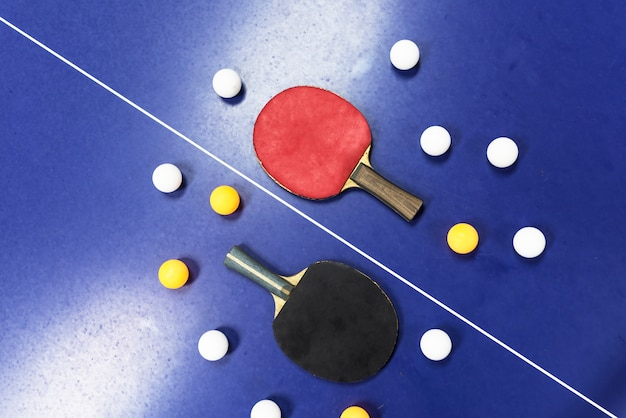 Rackets on a ping pong table