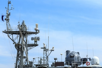 Radar of warship at the harbor in Thailand on blue sky
