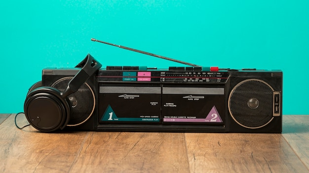 Radio cassette and black headphones