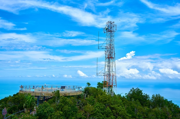 Radio communication tower on a background of blue sky.