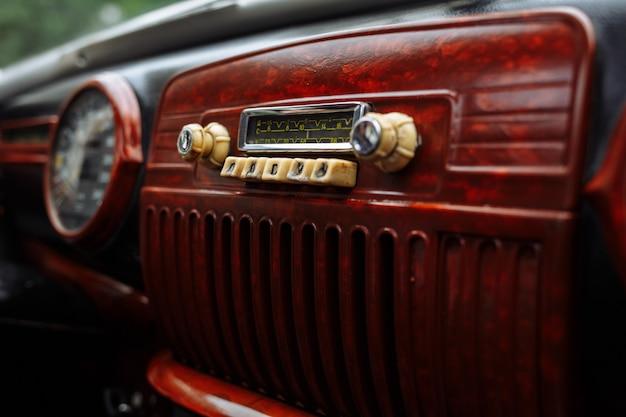 Radio on dashboard of old vintage automobile. interior of a classic retro car.