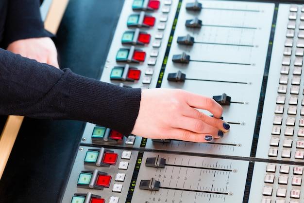 Radio presenter in radio station on air