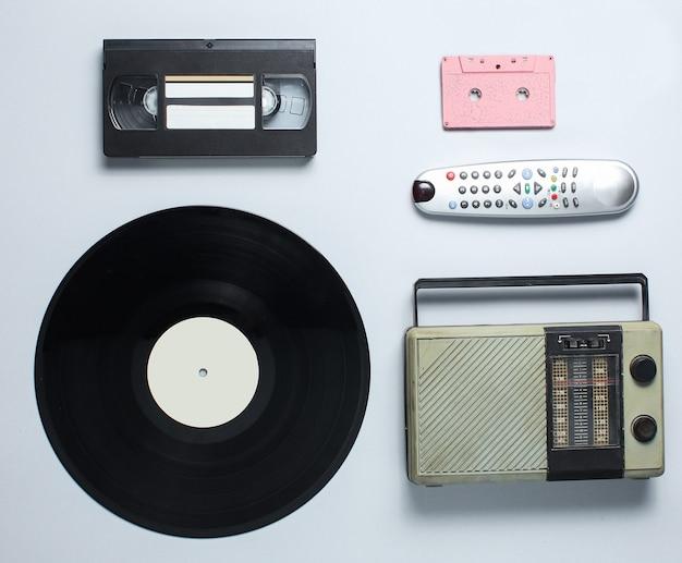 Radio receiver, vinyl record, audio cassette, video cassette, tv remote