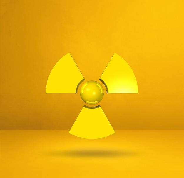 黄色のスタジオの背景に分離された放射性シンボル。 3dイラスト