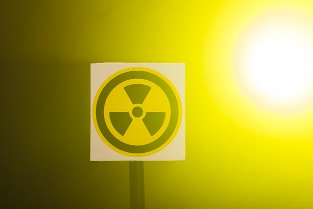 Radioactivity and sign concept - radiation hazard sign on background