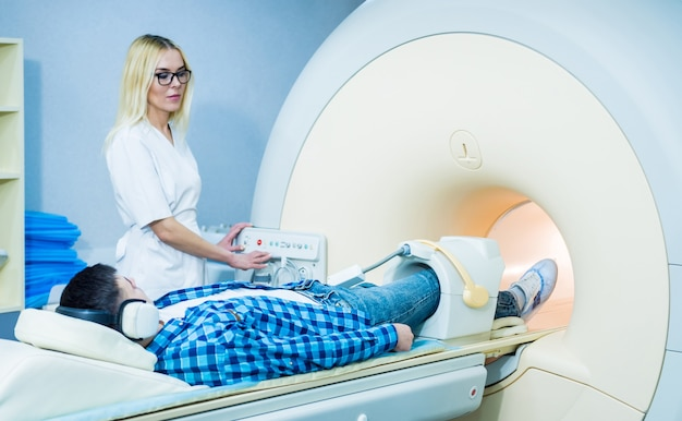 Radiologist prepares patient for an mri knee examination.