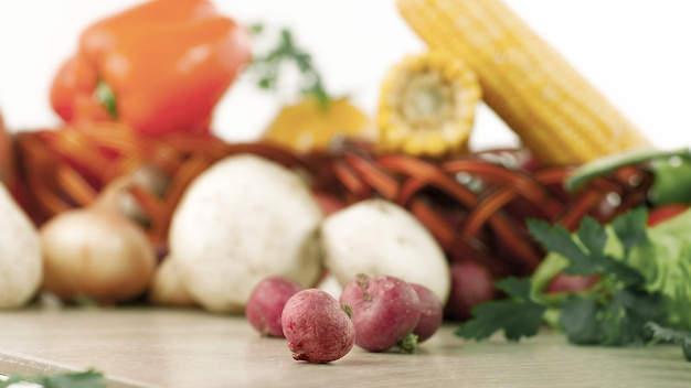 Radishes on a background of fresh vegetables