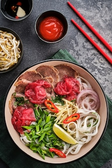 Raditional  vietnamese soup pho bo  asian food concept top view