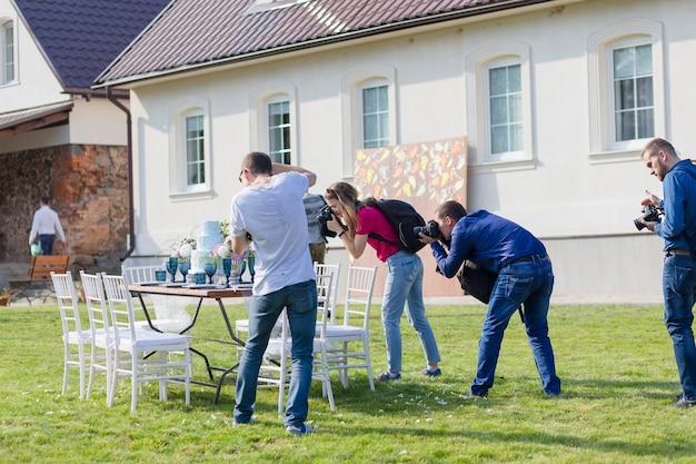 Radzivilki, belarus - oct 10: photographers shoot decorated for wedding elegant dinner table at the wedding workshop at october 10, 2016 in radzivilki, belarus