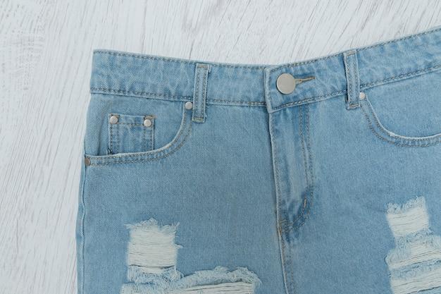 Ragged denim shorts. close up. fashiable