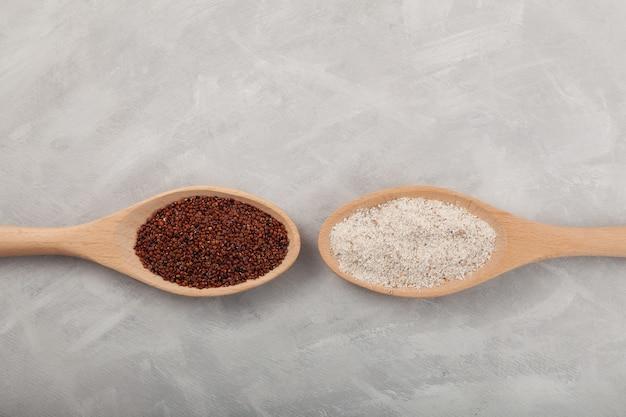 Ragi or nachni also known as finger millet and ragi flour in wooden spoons gluten free