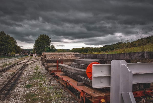 Railroad crossing against cloudy backdrop