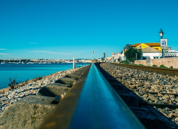 Railroad of faro next to the sea.