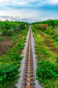 Railroad and railway train transportation with color of sky sunlight