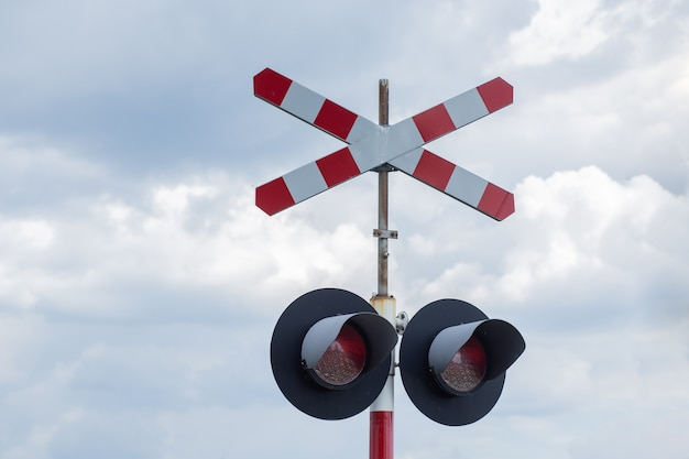 Railroad sign on sky background