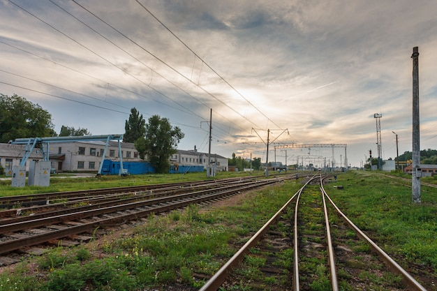 Railroads against beautiful sky at sunset. industrial landscape with railway junction. heavy industry