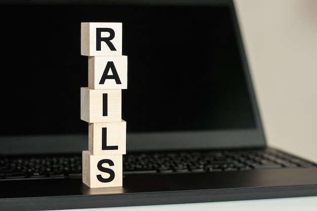 Rails text written on wooden block on computer keyboard . business concept.