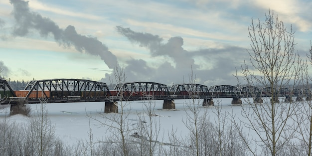Railway bridge over frozen lake, highway 16, yellowhead highway, prince george, british columbia, ca