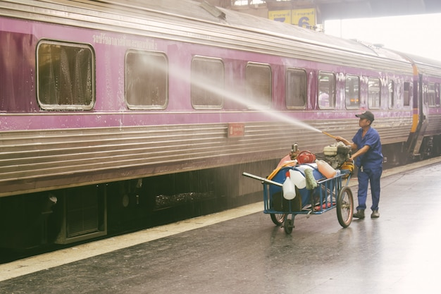 Railway employees doing cleaning train to prepare service for the safety of tourists
